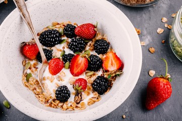 healthy breakfast bowl with homemade granola fresh blackberries and strawberries