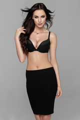 Beautiful female model wear black skirt and bra