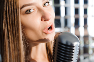 Beautiful Singing Girl. Beauty Woman with Microphone. Glamour Model Singer. Karaoke song