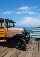 Old Woody vintage paneled truck parked on wooden pier