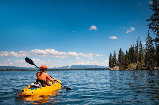 Woman kayaking on Lake Jenny in Grand Tetons National Park