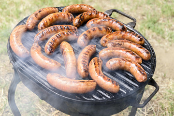 Sausages and white meat roasted on the grill