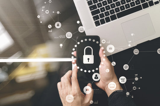 cyber security internet and networking concept.Businessman hand working with VR screen padlock icon on mobile phone and digital tablet laptop computer