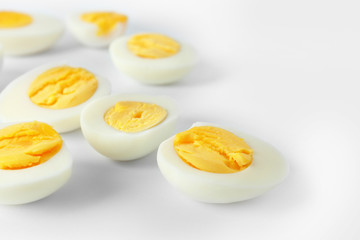 Sliced hard boiled eggs on white background. Nutrition concept