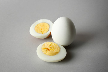 Hard boiled eggs on grey background. Nutrition concept