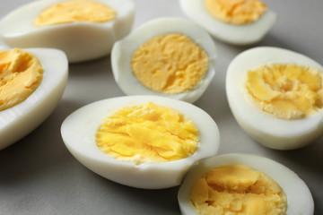 Sliced hard boiled eggs, closeup. Nutrition concept