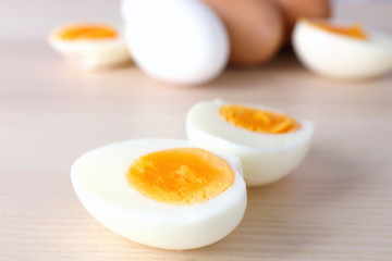 Sliced hard boiled eggs on light background. Nutrition concept