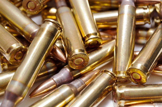 A close up of loaded 223 brass ammo