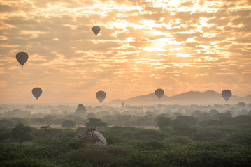 Hot air balloon over ancient pagoda in Bagan, Myanmar