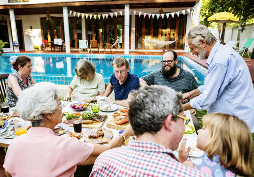 Group of diverse people enjoying barbecue party together