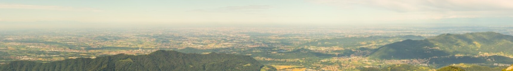 Great landscape on the Padana plain in summer time. Panorama from Linzone Mountain, Bergamo, Italy.