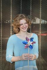 Smiling girl holding pinwheel