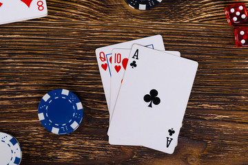 A good set of cards on a wooden table, to win