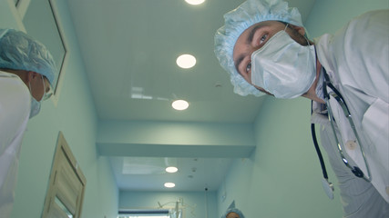 Surgeons looking down at patient getting ready for urgent surgery