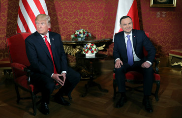 U.S. President Donald Trump is greeted by Polish President Andrzej Duda in Warsaw