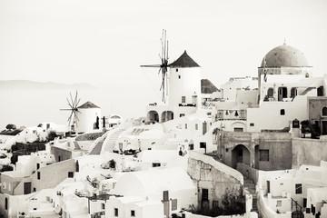 Traditional Oia windmills in Santorini, sepia toned black and white photo