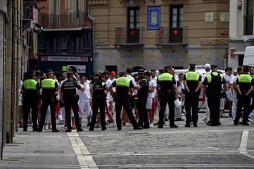Police clear the town hall square as part of security measures before the Chupinazo, the official start of the San Fermin festival, in Pamplona