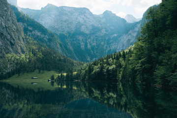 Mountain lake in south Germany with forest and reflection