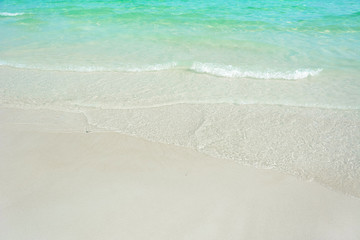 White sand beach with crystal clear sea water