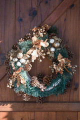 Green christmas wreath with decorations adorn the doors.