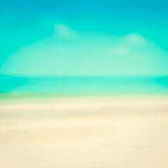 Blurred white sand beach and blue sky
