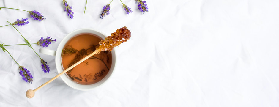Lavender tea with fresh flowers and sugar stick