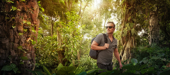 traveler with backpack studies ancient ruins in jungles.