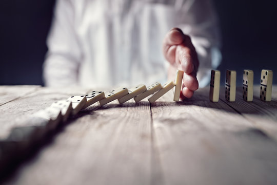 Stop the domino effect concept for business solution and intervention