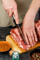 Close up of Male hands chopping knife pork