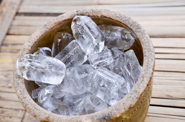 Ice cubes on wooden bucket