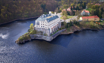 Aerial view on czech romantic, gothic chateâu Orlik, situated on rock outcrop above  Orlik reservoir in beautiful spring nature.Romantic, royal Schwarzenberg castle above water level. Czech landscape.
