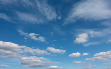 Beautiful clouds flying against blue sky at sunny day.