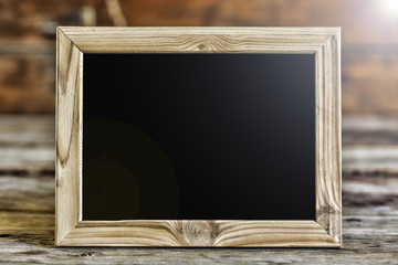 Wooden frame with black background. Copy space for your text. Free copy space