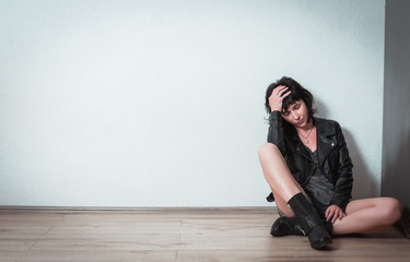 Woman in depression sitting alone at home