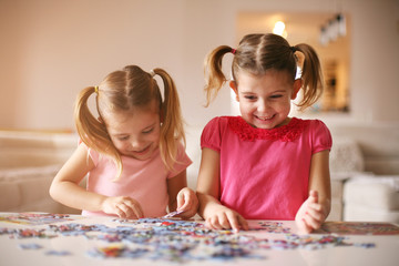 Girls playing puzzle