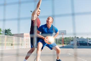 Sportsmen playing Basketball