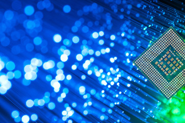 Computer Processor Chip On Fiber Optics Background