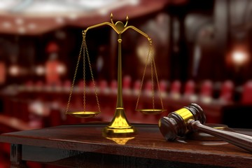 Scales and a judge hammer in the courtroom