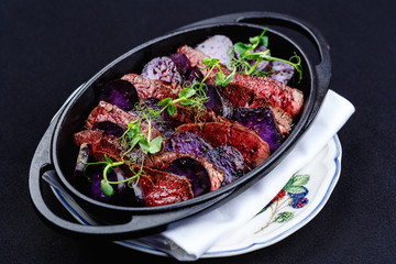 Stew meat with slices of beetroot.