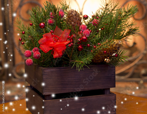 christmas decoration on background of fireplacered beadsfir cones tree branches in wooden - Wooden Box Christmas Decorations