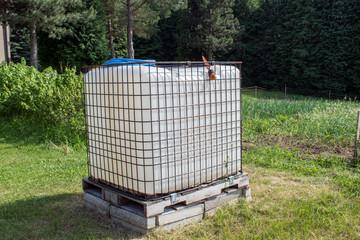 Square plastic water tank in the garden.rainwater recuperator baril