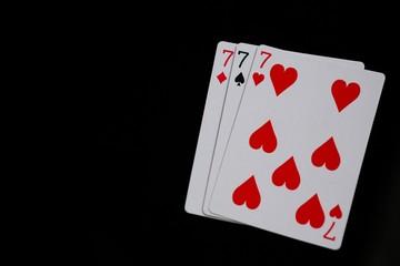 Close-up of three cards