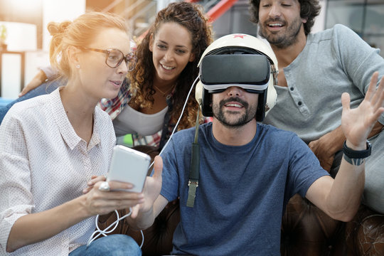 Group of friends playing together with virtual reality headset