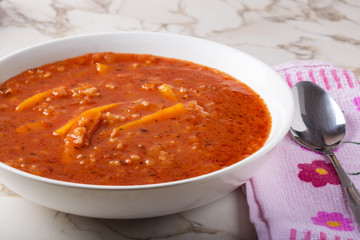 Summer soup made from tomato sauce, rice and carrot
