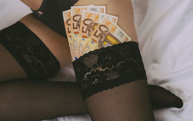 Prostitute in lingerie with money. Close-up view.