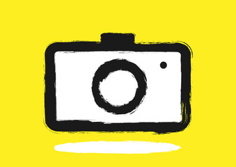 Logo camera painted by hand with a rough brush. Grunge, sketch, graffiti, ink. Black, white, yellow.
