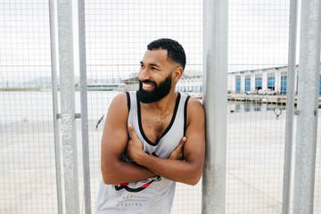 Sportive man posing in squat