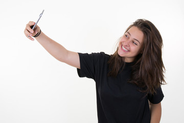 Pretty young teen girl taking a selfie