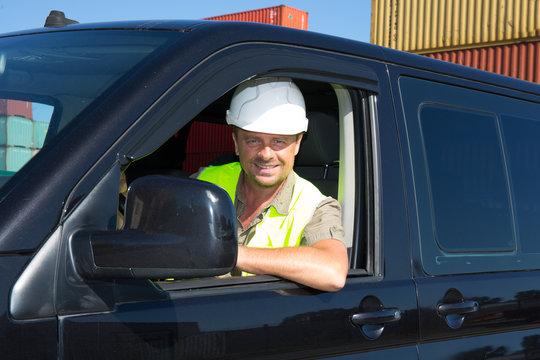 Engineer builder at construction site driver In Van