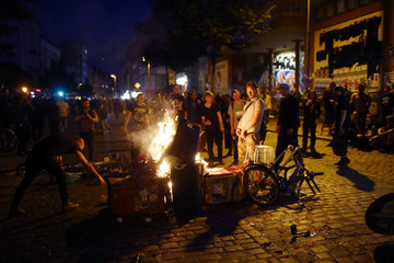 Protesters burn a fire on the street during the demonstration during the G20 summit in Hamburg